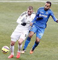 Getafe's  Diego Castro (r) and Real Madrid's Karim Benzema during La Liga match.January 18,2013. (ALTERPHOTOS/Acero) /NortePhoto<br /> NortePhoto.com