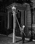 Lamplighter, Kensington 1930s