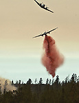 Greeley Hill, California-- July 29, 2008-Telegraph Fire-Wildfires Threaten Yosemite National Park .Guide plane leads retardant bomber on Division M of the Telegraph Fire in an attempt to slow down the progression of the fire up Halls Gulch toward Greeley Hill community. The is the active edge of the fire. ..Photo by Al Golub/Golub Photography.