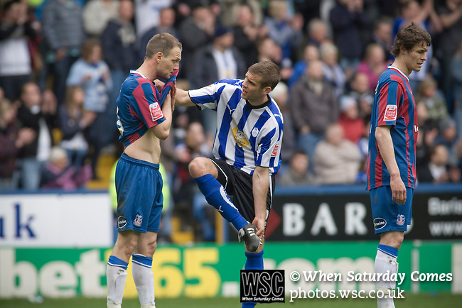 Crystal Palace defender Clint Hill has a conversation with Sheffield Wednesday defender Tommy Spurr (centre) at Hillsborough during the crucial last-day relegation match against Sheffield Wednesday. The match ended in a 2-2 draw which meant Wednesday were relegated to League 1. Crystal Palace remained in the Championship despite having been deducted 10 points for entering administration during the season.