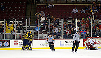 Michigan celebrates their winning goal in the third period while OSU goaltender Logan Davis looks down at Value City Arena in Columbus Dec. 2, 2013.  (Dispatch photo by Eric Albrecht)