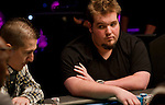 Christopher DeMaci , right, eyes Ray Henson, left, during a hand at the final table.