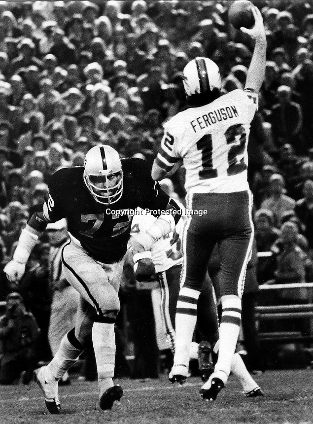 John Matusak puts a rush on Joe Ferguson, 1977.  photo by Ron Riesterer