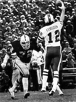 John Matusak puts a rush on Joe Ferguson, 1977.  photo by Ron Riesterer