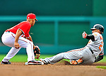19 June 2011: Baltimore Orioles' outfielder Nick Markakis slides safely into second during play against the Washington Nationals on Father's Day at Nationals Park in Washington, District of Columbia. The Orioles defeated the Nationals 7-4 in inter-league play, ending Washington's 8-game winning streak. Mandatory Credit: Ed Wolfstein Photo