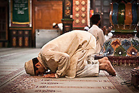 Kashmri muslim man praying at a Dastgir Saheb shrine of a sufi saint in Srinagar. Muslims around the world are attending the holy month of Ramadan, where they observe the devout fast from dawn to dusk.