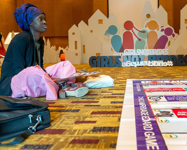 26 June, 2018, Kuala Lumpur, Malaysia : Rokhaya Ngom watching her group play the Child Marriage Board game during a session at The Village on the second day at the Girls Not Brides Global Meeting 2018 at the Kuala Lumpur Convention Centre. Picture by Graham Crouch/Girls Not Brides