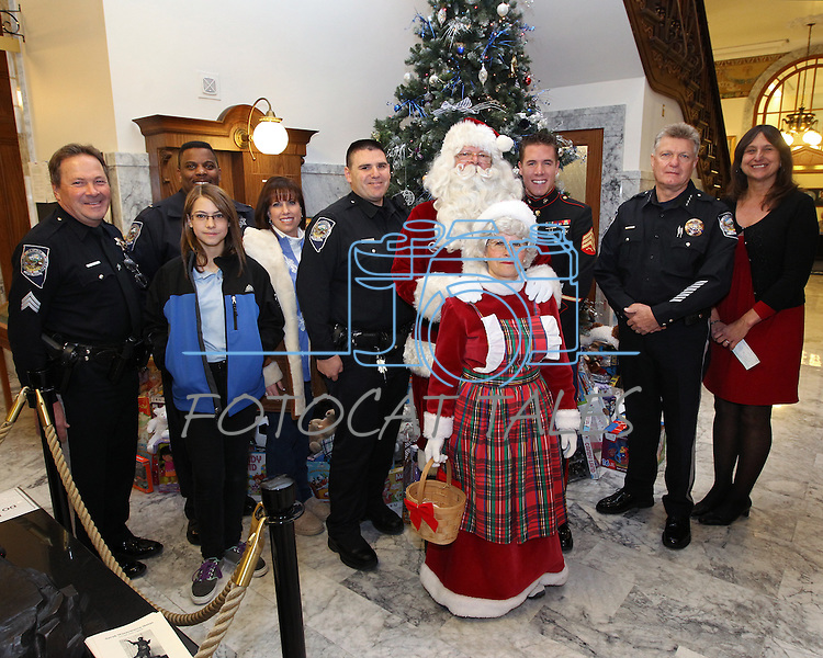 Representatives from a number of agencies who particiated in the 8th annual Toys for Tots toy drive coordinated by the Capitol Police, pose Friday, Dec. 17, 2010, at the Capitol in Carson City, Nev. .Photo by Cathleen Allison