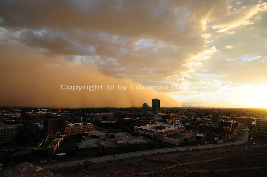 "Phoenix, Arizona (September 6, 2014) -- The dust storm blew through Phoenix as Hurricane Norbert is bringing moisture into Arizona. A massive dust storm sweeps into the Phoenix metropolitan area blanketing the Valley. The phenomenon created a massive wall of dust, also called ""baboob"". The dust storm was followed by thunderstorms producing very heavy rain.  Photo by Eduardo Barraza © 2014"