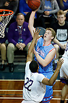 SIOUX FALLS, SD - MARCH 9:  Jason Spicer #40 from Dakota Wesleyan shoots over Aziz Leeks #22 from the College of Idaho during their second round game at the 2018 NAIA DII Men's Basketball Championship at the Sanford Pentagon in Sioux Falls. (Photo by Dick Carlson/Inertia)