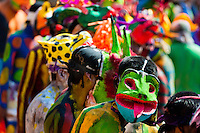 "Cora Indians, wearing colorful demon masks, run during the sacred ritual ceremony of Semana Santa (Holy Week) in Jesús María, Nayarit, Mexico, 22 April 2011. The annual week-long Easter festivity (called ""La Judea""), performed in the rugged mountain country of Sierra del Nayar, merges indigenous tradition (agricultural cycle and the regeneration of life worshipping) and animistic beliefs with the Christian dogma. Each year in the spring, the Cora villages are taken over by hundreds of wildly running men. Painted all over their semi-naked bodies, fighting ritual battles with wooden swords and dancing crazily, they perform demons (the evil) that metaphorically chase Jesus Christ, kill him, but finally fail due to his resurrection. La Judea, the Holy Week sacred spectacle, represents the most truthful expression of the Coras' culture, religiosity and identity."