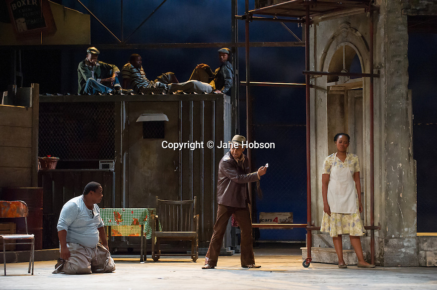 London, UK. 10.07.2012. Cape Town Opera returns to the London Coliseum with their acclaimed production of Porgy and Bess. Picture shows:  Xolela Sixaba (Porgy), Victor Ryan Robertson (Sporting Life) and Nonhlanhla Yende (Bess). Photo credit: Jane Hobson