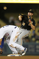 Pittsburgh Pirates second baseman Neil Walker #18 attempts to turn a double play against the Los Angeles Dodgers at Dodger Stadium on September 16, 2011 in Los Angeles,California. Los Angeles defeated Pittsburgh 7-2.(Larry Goren/Four Seam Images)