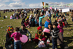Families sit on the grass while listening to political speeches and music during Newroz, the Kurdish New Year celebration, in Suruç, Turkey, March 17, 2015. Newroz, or Nowruz, is an ancient holiday celebrated by a multitude of ethnic groups across Iran, Central Asia, and the Caucuses, and ushers in the first day of Spring, March 21. For Kurds, Newroz is a means of political and cultural expression, featuring Kurdish politicians, activists, and musicians, and has become a manifestation of Kurdish identity. In Turkey, the celebrations begin a few days before the Vernal Equinox, culminating in a huge gathering in the heart of Turkey's Kurdish population, the southeastern city of Diyarbakir. This year, PKK founder Abdullah Öcalan, who despite serving a life sentence for treason still enjoys widespread influence among Kurds, sent a letter that was read at Newroz in Diyarbakir, calling for an end to the PKK's armed struggle against the Turkish state.