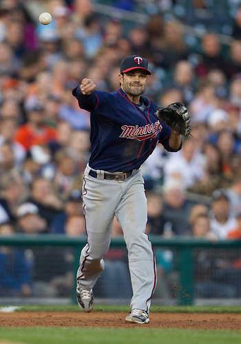 May 16, 2012:  Minnesota Twins third baseman Jamey Carroll (8) throws the ball to first base during MLB game action between the Minnesota Twins and the Detroit Tigers at Comerica Park in Detroit, Michigan.  The Twins defeated the Tigers 11-7.