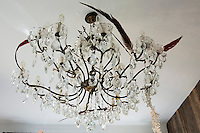 The crystal chandelier in the bathroom is decorated with feathers