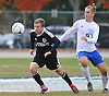 Ward Melville No. 6 Harry Radke, left, and North Babylon No. 9 Luan Elmazi race after a loose ball durng a Suffolk County varsity boys' soccer Class AA first round playoff game at North Babylon High School on Tuesday, October 27, 2015. Ward Melville won by a score of 1-0.<br /> <br /> James Escher