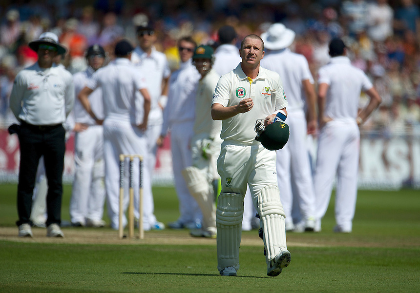 Australia's Brad Haddin walks back to the pavilion after losing his wicket to England's Graeme Swann   - BJ Haddin&dagger; b Swann 1<br /> <br />  (Photo by Stephen White/CameraSport) <br /> <br /> International Cricket - First Investec Ashes Test Match - England v Australia - Day 2 - Thursday 11th July 2013 - Trent Bridge - Nottingham<br /> <br /> &copy; CameraSport - 43 Linden Ave. Countesthorpe. Leicester. England. LE8 5PG - Tel: +44 (0) 116 277 4147 - admin@camerasport.com - www.camerasport.com