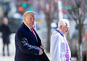 United States President Donald J. Trump (L) is escorted by Reverend W. Bruce McPherson (R) after attending services at St. John's Episcopal Church in Washington, DC, USA, 17 March 2019. The Trumps attended church on St. Patrick's Day.<br /> Credit: Erik S. Lesser / Pool via CNP