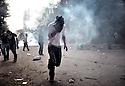 Protester during tear gas shooting. after three days of deadly violence between demonstrators and security forces, the military challenge in Egypt reached an agreement with representatives of five political parties.