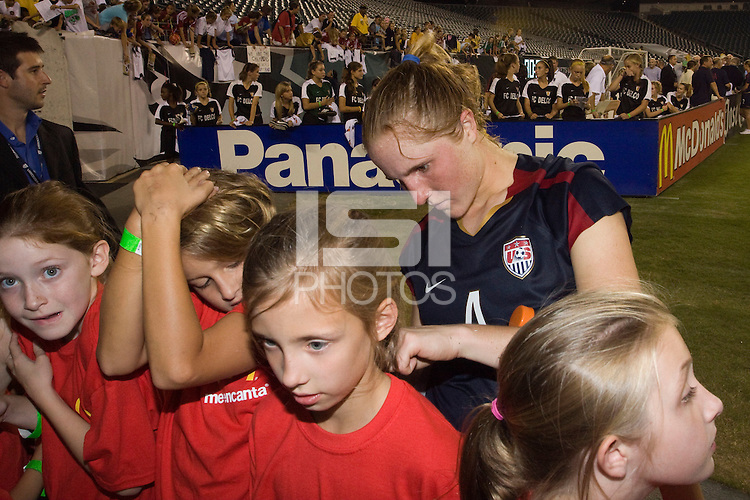 United States (USA) defender Rachel Buehler (4) signs autographs after the game. The United States Women's National Team (USA) defeated the Republic of Ireland (IRL) 2-0 during an international friendly at Lincoln Financial Field in Philadelphia, PA, on September 13, 2008.