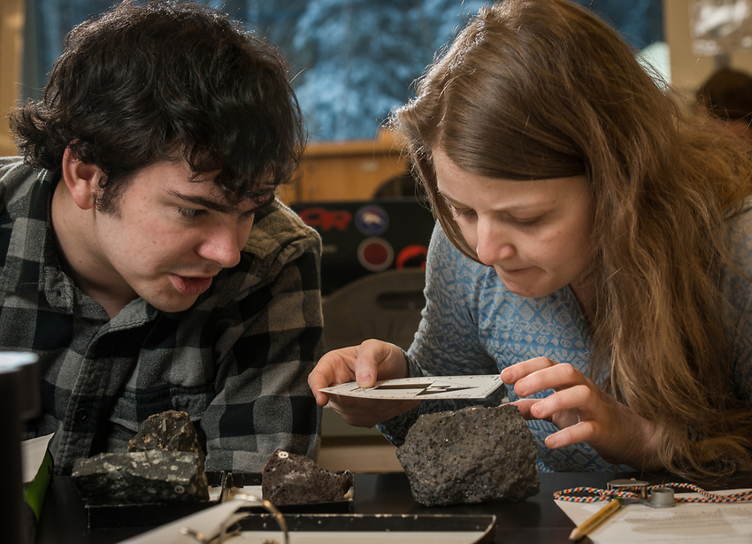 Zach Spath and Monika Fleming interpret rock samples during a lab exercise for Geology Professor Erin Shea's Igneous and Metamorphic Petrology class (GEOL A322) in UAA's ConocoPhillips Integrated Science Building. Students in GEOL A322 learn to identify and classify igneous and metamorphic rocks; interpret different rock textures, structures, and mineralogy; and learn about the chemical and physical principles that control the formation of rocks.