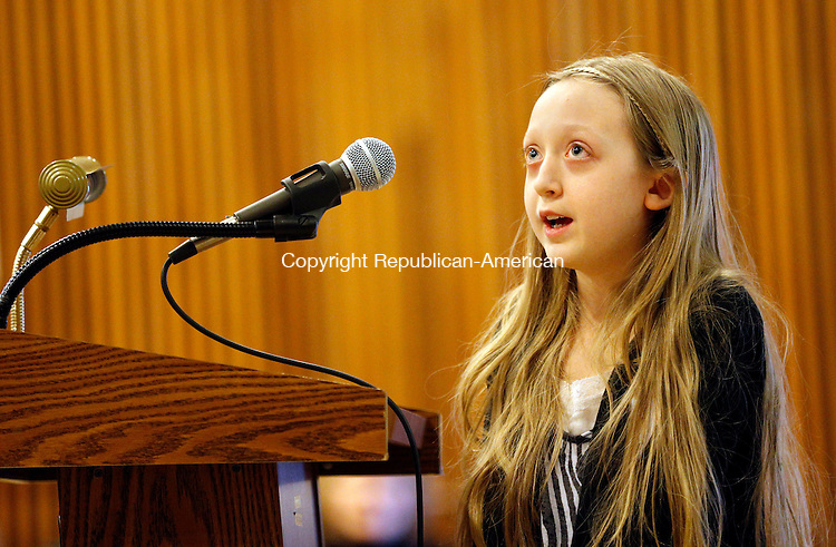 """WINSTED, CT- 23 March 2015-032315CM02-  Eleanor Oakes-Rogers,12 and a student at The Gilbert School, spells a word during a spelling bee which was held in the Roberta Ohotnicky Theater at Northwestern Regional High School in Winsted on Monday. Jill Keegan, 13, and a student at Northwestern Middle School Keegan won the event after spelling """"wunderkind"""" (phonetically spelled vun-der-kint) correctly, which according to Merriam-Webster means, """"someone who achieves success or shows great talent at a young age"""", won her first place at the event.  Students from Northwestern Middle School, The Gilbert School, and St. Anthony's School competed in the inaugural  event which was sponsored by Northwestern Community Bank and the Republican-American. Keegan received a 100 dollar gift card to Barnes and Noble. Second prize went to Oakes-Rogers, who received a 50 dollar gift card to Barnes and Noble.  Christopher Massa Republican-American"""