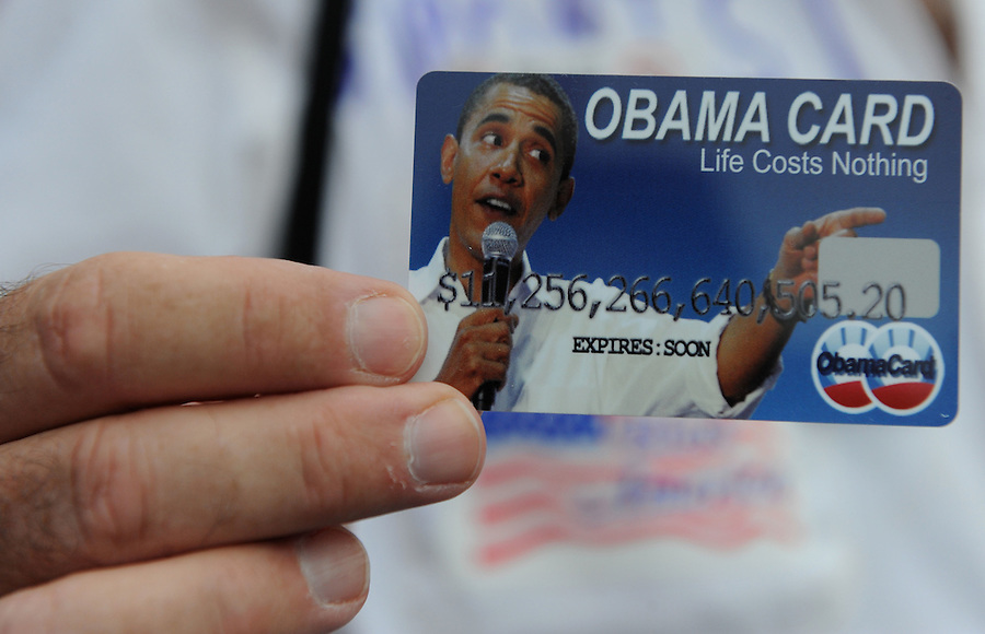 Bobby More, 59, of Athens, Ga, holds onto his Obama card at Freedom Plaza during the Tea Party Protest on Sept. 12, 2009.