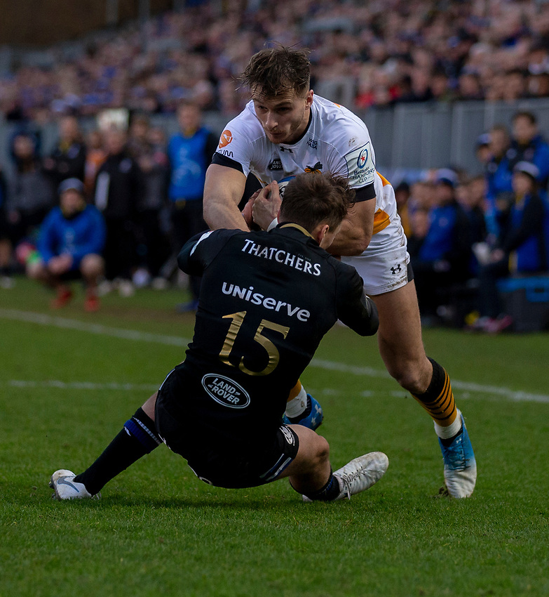 Wasps' Josh Bassett is tackled by Bath Rugby's Darren Atkins<br /> <br /> Photographer Bob Bradford/CameraSport<br /> <br /> European Rugby Heineken Champions Cup Pool 1 - Bath Rugby v Wasps - Saturday 12th January 2019 - The Recreation Ground - Bath<br /> <br /> World Copyright © 2019 CameraSport. All rights reserved. 43 Linden Ave. Countesthorpe. Leicester. England. LE8 5PG - Tel: +44 (0) 116 277 4147 - admin@camerasport.com - www.camerasport.com