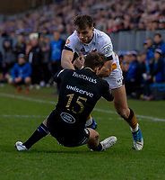 Wasps' Josh Bassett is tackled by Bath Rugby's Darren Atkins<br /> <br /> Photographer Bob Bradford/CameraSport<br /> <br /> European Rugby Heineken Champions Cup Pool 1 - Bath Rugby v Wasps - Saturday 12th January 2019 - The Recreation Ground - Bath<br /> <br /> World Copyright &copy; 2019 CameraSport. All rights reserved. 43 Linden Ave. Countesthorpe. Leicester. England. LE8 5PG - Tel: +44 (0) 116 277 4147 - admin@camerasport.com - www.camerasport.com