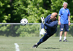 Kasey Keller dives to make a save on Saturday, May 20th, 2006 at SAS Soccer Park in Cary, North Carolina. The United States Men's National Soccer Team held a training session as part of their preparations for the upcoming 2006 FIFA World Cup Finals being held in Germany.