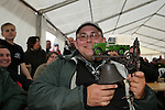 Jérome Boufferet, a french Land Rover enthusiast proudly showing his auction trophy after having successfully bid at the famous saturday night Dunsfold Collection auction. Dunsfold Collection of Land Rovers Open Day 2011, Dunsfold, Surrey, UK. --- No releases available, but releases may not be necessary for certain uses. Automotive trademarks are the property of the trademark holder, authorization may be needed for some uses.