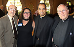 WATERBURY CT. 17 July 2017-071717SV08-From left, Deacon George Pettinico of Watertown, Franki O&rsquo;Leary of Prospect, Rev. Joseph Pullikattil of West Hartford, and Rev. Francis Johnson of West Hartford attend a dinner to honor the retiring Rev. Ronald Ferraro at La Bella Vista in Waterbury Monday. After 57 years of service, the Rev. Ferraro will retire as pastor of Our Lady of Lourdes Church, where he has served since 1990.<br /> Steven Valenti Republican-American