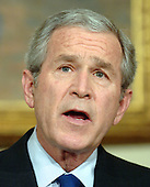 Washington, D.C. - March 19, 2007 -- United States President George W. Bush makes a statement marking the fourth anniversary of the start of the war in Iraq from the Roosevelt Room of the White House on Monday, March 19, 2007. <br /> Credit: Roger L. Wollenberg - Pool via CNP