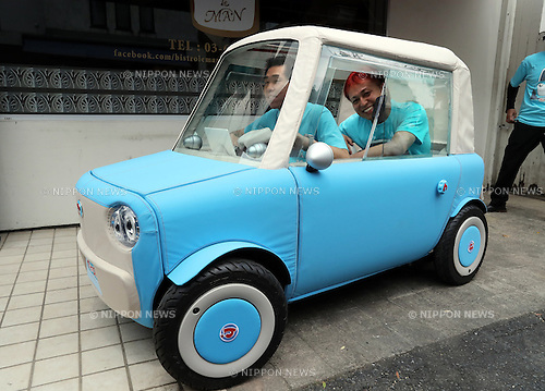 """May 20, 2016, Tokyo, Japan - Japanese automobile venture rimOnO president Shinsuke Ito (front) and car designer Kota Nezu (rear) display the prototype model of the electric powered personal mobility """"rimOnO"""" in Tokyo on Friday, May 20, 2016. The rimOnO, 2m in length and 1m wideth, is equipped with in-wheel motors to drive two seater light weight body which is made by soft materials.  (Photo by Yoshio Tsunoda/AFLO) LWX -ytd-"""