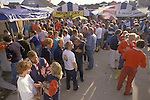 Cowes Regatta. Groves and Gutteridge yard at Cowes end of day drinking. From The English Season published by Pavilon Books
