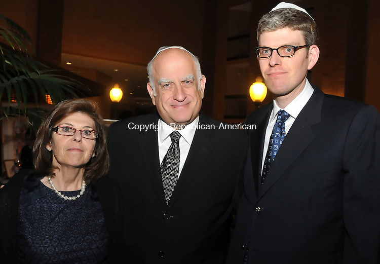 WATERBURY, CT-01 NOVEMBER 2009-110109JS08-Susan Oppenheim of Sailsbury with her husband Stanley Openheim and son Joshua Oppenheim at The Holtzberg Memorial Sefer Torah dedication ceremony hosted by the Chabad Lubavitch of Northwest Connecticut Sunday at the Holiday Inn in Waterbury.  The Holtzberg Memorial Sefer Torah is in memory of Rabbi Gavriel Holtzberg and his wife Rivka who were killed last year during the Mumbai massacre in India, where they were serving as directors of the Chabad House there. <br /> Jim Shannon Republican-American