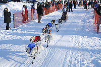 Saturday, February 24th, Knik, Alaska.  Jr. Iditarod musher Michael Owens  leaves start line on Knik Lake