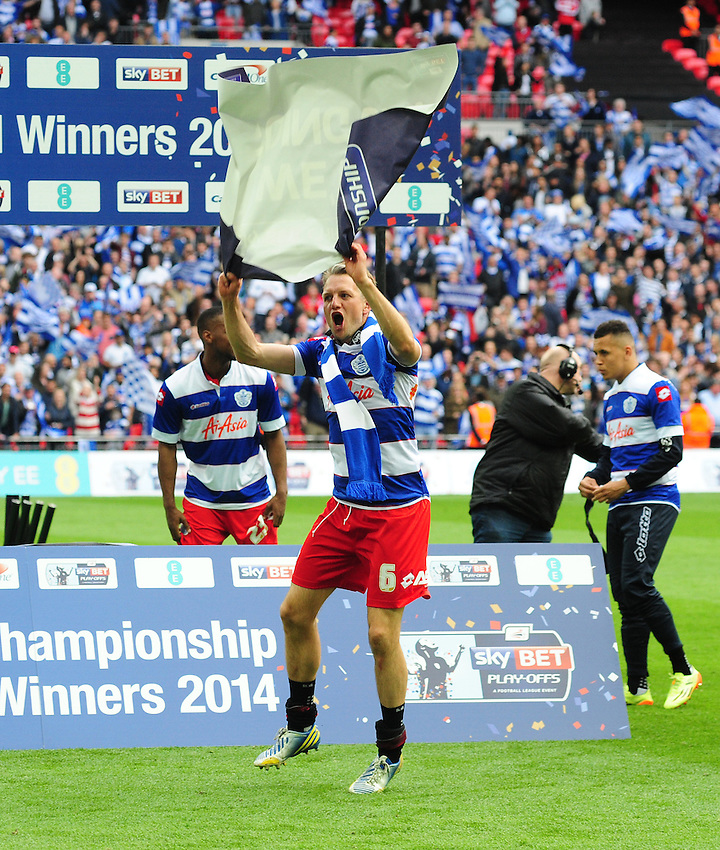 Queens Park Rangers' Clint Hill celebrates his sides promotion to the Premier League<br /> <br /> Photographer Chris Vaughan/CameraSport<br /> <br /> Football - The Football League Sky Bet Championship Play-Off Final - Derby County v Queens Park Rangers - Saturday 24th May 2014 - Wembley Stadium - London<br /> <br /> &copy; CameraSport - 43 Linden Ave. Countesthorpe. Leicester. England. LE8 5PG - Tel: +44 (0) 116 277 4147 - admin@camerasport.com - www.camerasport.com