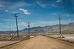 Road across the dry lake bed, power lines, Silver Peak, Nev.