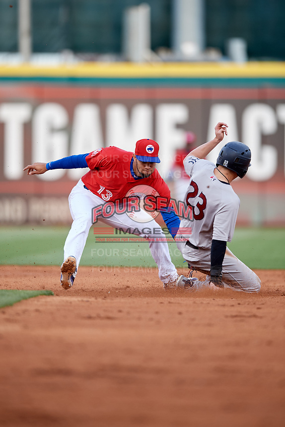 Buffalo Bisons shortstop Lourdes Gurriel Jr. (13) puts a tag on Tyler Wade (23) during a game against the Scranton/Wilkes-Barre RailRiders on May 18, 2018 at Coca-Cola Field in Buffalo, New York.  Buffalo defeated Scranton/Wilkes-Barre 5-1.  (Mike Janes/Four Seam Images)