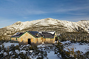 Greenleaf Hut in the White Mountains of New Hampshire during the winter months. This shelter is located just below the summit of Mount Lafayette along the Greenleaf Trail. And it is closed during the winter season.