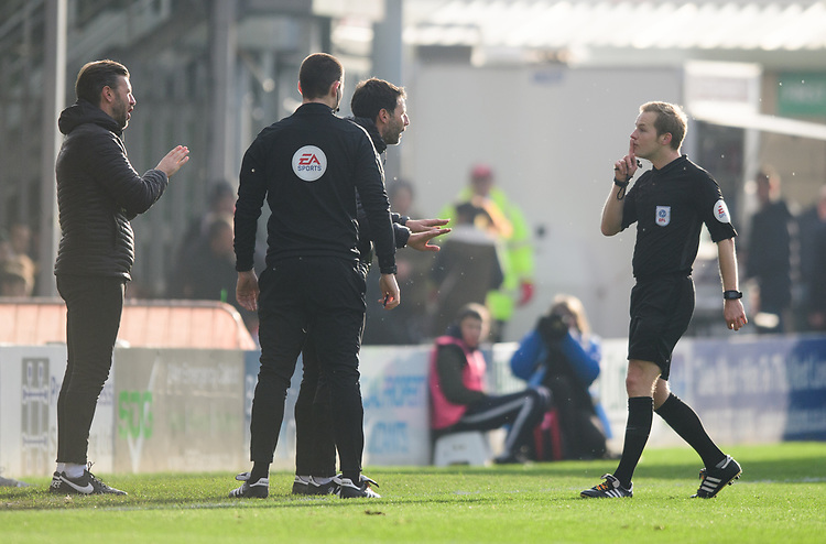 Referee Gavin Ward, right, speaks to Lincoln City manager Danny Cowley, centre, as Lincoln City's assistant manager Nicky Cowley, left, watches on<br /> <br /> Photographer Chris Vaughan/CameraSport<br /> <br /> The EFL Sky Bet League Two - Lincoln City v Mansfield Town - Saturday 24th November 2018 - Sincil Bank - Lincoln<br /> <br /> World Copyright © 2018 CameraSport. All rights reserved. 43 Linden Ave. Countesthorpe. Leicester. England. LE8 5PG - Tel: +44 (0) 116 277 4147 - admin@camerasport.com - www.camerasport.com
