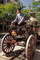 AJ3438, fire engine, fire truck, Allentown, Pennsylvania, Fireman sits on old fashioned fire truck in downtown Allentown in the state of Pennsylvania.