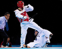 04 DEC 2011 - LONDON, GBR - Sang-Bin Lee (KOR) (on left, in red) battles with Ramin Azizov (AZE) (on right, in blue) during their men's -80kg category semi final contest at the London International Taekwondo Invitational and 2012 Olympic Games test event at the ExCel Exhibition Centre in London, Great Britain .(PHOTO (C) NIGEL FARROW)