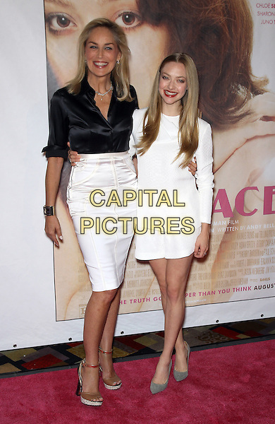Sharon Stone, Amanda Seyfried<br /> 'Lovelace' VIP Screening at Planet Hollywood Resort and Casino, Las Vegas, NV., USA.<br /> August 4th, 2013<br /> full length black silk satin blouse white skirt dress smiling   <br /> CAP/ADM/MJT<br /> &copy; MJT/AdMedia/Capital Pictures