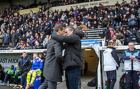 Wycombe Wanderers Manager Gareth Ainsworth & Mark Cooper Manager of Notts County embrace during the Sky Bet League 2 match between Notts County and Wycombe Wanderers at Meadow Lane, Nottingham, England on 28 March 2016. Photo by Andy Rowland.