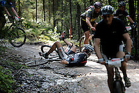 A rider takes a tumble going down a dirt track. Grenserittet is a 80km mountain bike race starting in the Swedish town of Strömstad, ending up in the Norwegian town Halden. The interest for these kind of bike races has exploded in Norway the last few years, particularly with middle age affluent men.