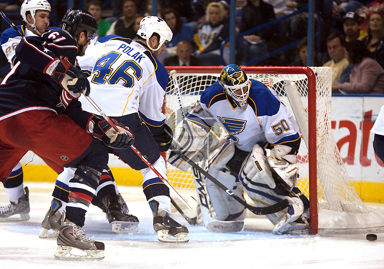 March 28 2009         The Blue Jackets' Rick Nash (61, left) and Blues Roman Polak (46, center) watch the puck slide by the front of the goal and Blues goalkeeper Chris Mason (50, right) in the second period.  The St. Louis Blues hosted the  Columbus Blue Jackets March 28, 2009 at the Scottrade Center in downtown St. Louis, Missouri...            *******EDITORIAL USE ONLY*******