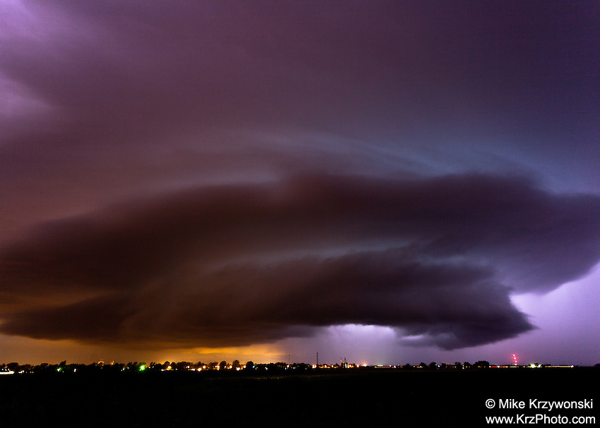Purple mothership supercell thunderstorm at night illuminated by lightning in Pierce, CO, June 7, 2012